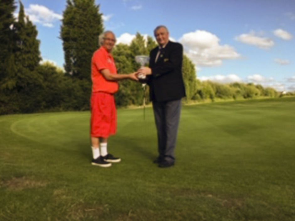 Dave Mellor receiving The Geoff Marks Trophy from Membership Secretary Michael Entecott